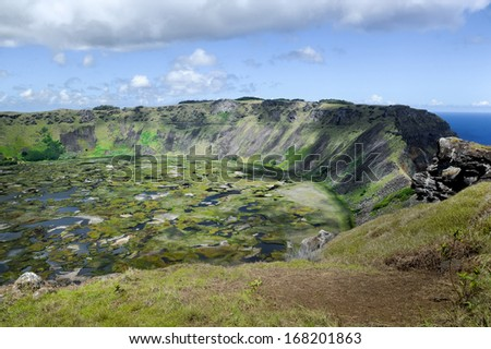 CHILE - FEBRUARY 7: The crater on Easter Island on February 7, 2012. It was created by the volcano that formed the land. - stock photo