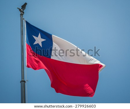 Chile flag flying in blue sky - stock photo