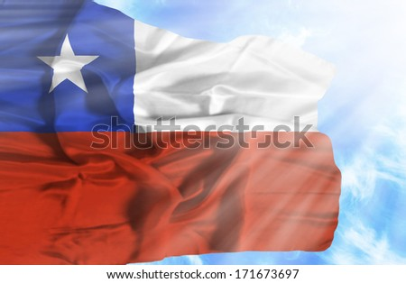 Chile waving flag against blue sky with sunrays - stock photo