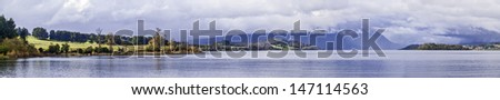 Chilean Patagonian landscape panorama with lake and mountains on winter. - stock photo