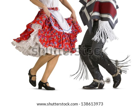 "Chilean typical dance ""cueca"" performed by a woman and a man (Huaso, Chilean cowboy) - stock photo"