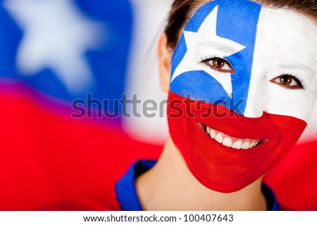 Chilean woman with the flag painted on her face - stock photo