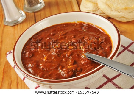 Chili con carne with fresh baked biscuits - stock photo