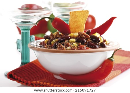 Chili con Carne with Tortilla chip on plate - stock photo