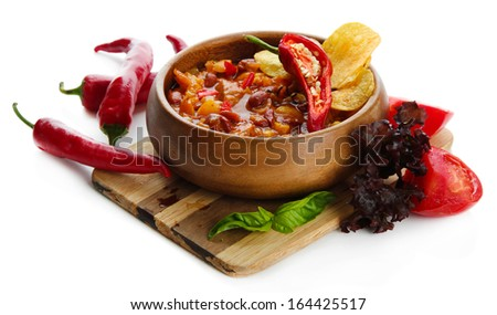 Chili Corn Carne - traditional mexican food, in wooden bowl, on  wooden board, isolated on white - stock photo