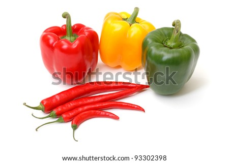 Chili pepper and paprika on white background - stock photo