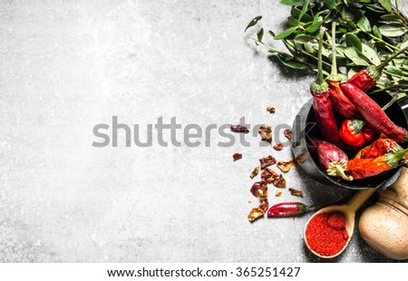 Chili pepper dried and ground in a spoon. On a stone background. Free space for text . Top view - stock photo