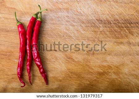 chili pepper on wood background - stock photo