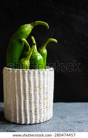 Chili peppers on the old wooden backgroud - stock photo