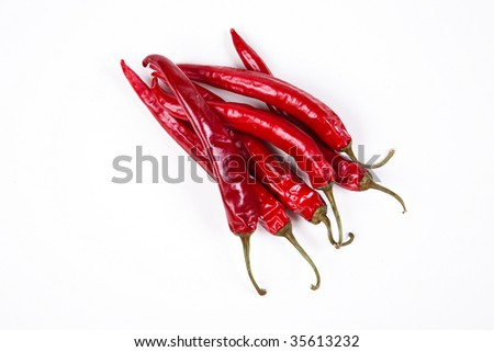 Chili peppers on white - stock photo