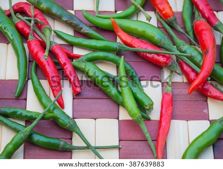 chili peppers on wooden table. - stock photo