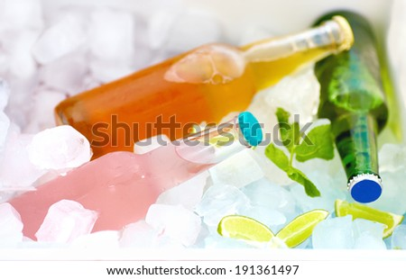 chilled colorful beverages in ice box. summer party - stock photo