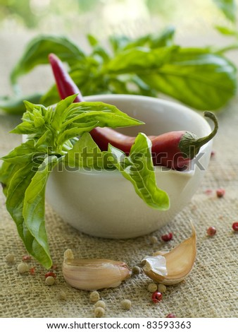 Chilli, basil and pepper on natural background. Selective focus - stock photo