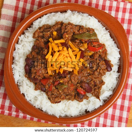 Chilli con carne with rice and grated cheese - stock photo