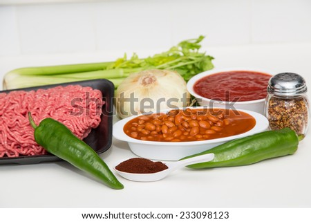 Chilli making ingredients on a white counter - stock photo