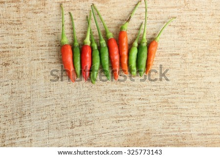 Chilli on wooden background - stock photo