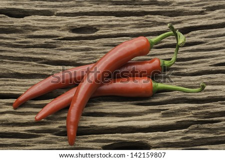 chillies on wood - stock photo