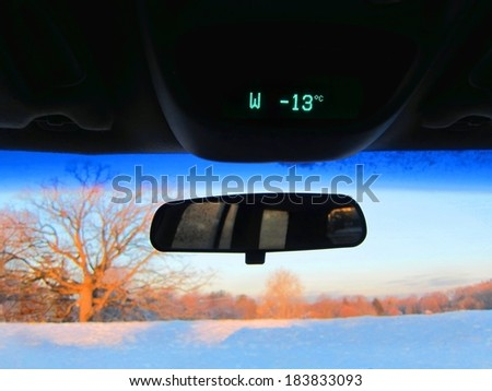 Chilly cold freezing snow background winter weather car auto temperature - stock photo