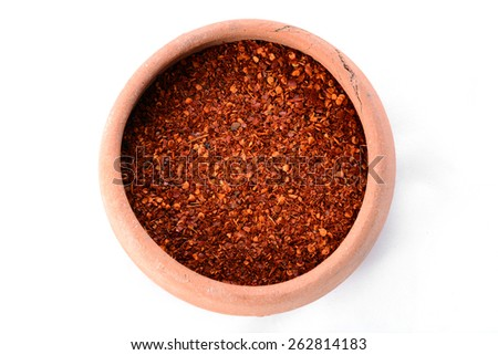 chilly powder on a white background - stock photo
