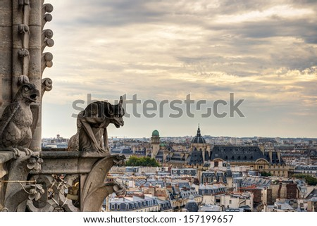 Chimera (gargoyles) of the Cathedral of Notre Dame de Paris overlooking Paris, France - stock photo