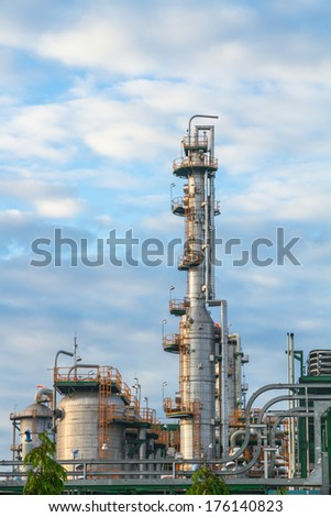 Chimney and tanks of Refinery plant - stock photo