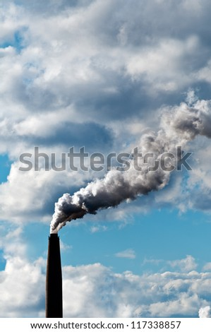 Chimney exhaust waste amount of CO2 into the atmosphere on a sunny day - stock photo