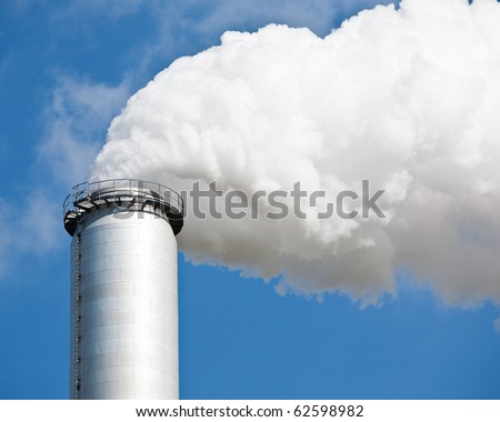 chimney in an industrial aerea - stock photo