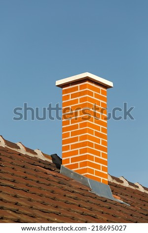 Chimney on a roof of a house - stock photo