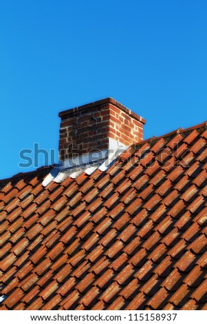 Chimney on a roof of an old residential house - stock photo