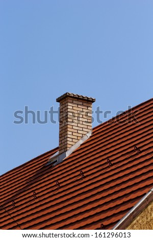 chimney on the roof - stock photo