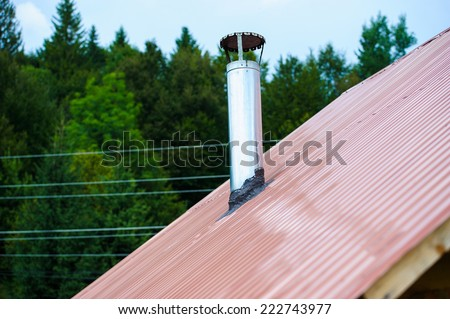 chimney on the roof of the house - stock photo
