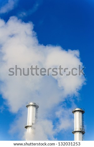 chimney smoke a wake for an industrial company. symbolic photo for environmental protection and ozone. - stock photo