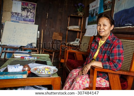 CHIN STATE, MYANMAR - JUNE 18 2015: Lady sitting in house in the recently opened for tourists Chin State Mountainous Region, Myanmar (Burma) - stock photo