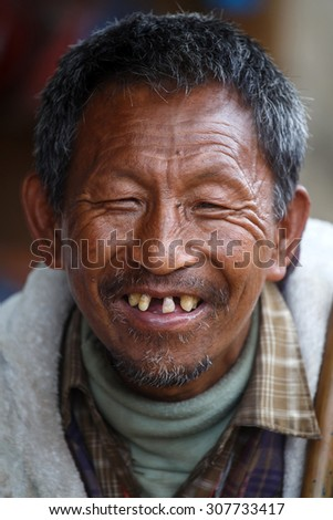 CHIN STATE, MYANMAR - JUNE 18 2015: Local weathered faced man with missing teeth in the recently opened for tourists Chin State Mountainous Region, Myanmar (Burma) - stock photo