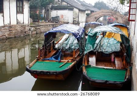 China/ancient water town/Zhouzhuang: two boats - stock photo