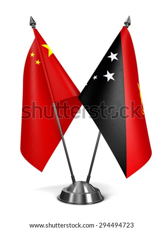 China and Papua New Guinea - Miniature Flags Isolated on White Background. - stock photo