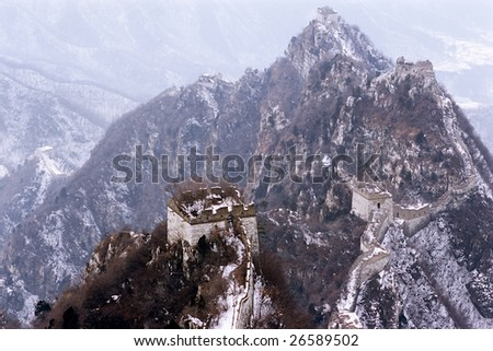 China/Beijing: The Great Wall of China in the snow - stock photo