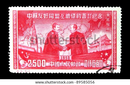 """CHINA - CIRCA 1950: A stamp printed in China shows Mao Tse-tung and Joseph Stalin, Russian-Asian background map and buildings w/o inscription from the series """"Soviet-Chinese friendship"""", circa 1950 - stock photo"""