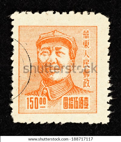 CHINA - CIRCA 1949: Orange color postage stamp printed in China with image of Mao Zedong. - stock photo
