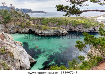 China Cove and Spectacular Rock Formations at Point Lobos State Natural Reserve. - stock photo