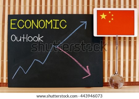 china flag and up and down arrow chart on the blackboard /chalkboard. The business concept of direction of economic outlook , currency, and stock market - stock photo