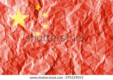 China flag painted on crumpled paper background. - stock photo