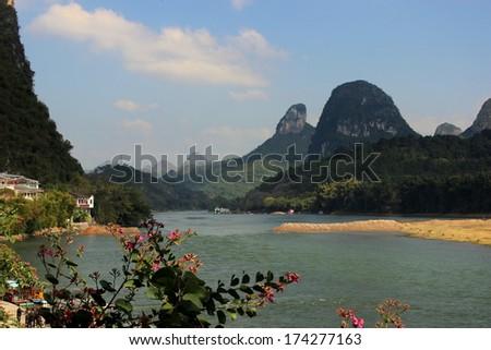 China River Bank Mountains back ground - stock photo