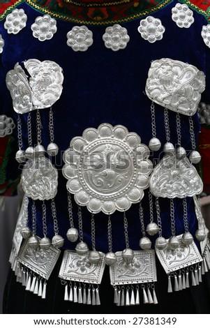 China's Guizhou Miao women in beautiful clothes back. - stock photo