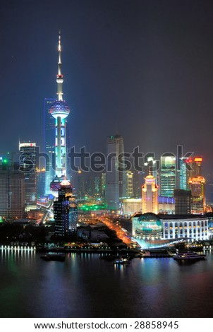 China Shanghai  Pudong aerial night view of the pearl tower. - stock photo