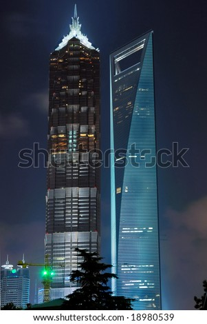 China Shanghai Pudong night view of the jin mao tower and  the shanghai world financial center  building. - stock photo