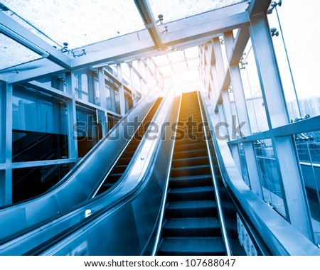 China Shanghai subway station escalators and people - stock photo