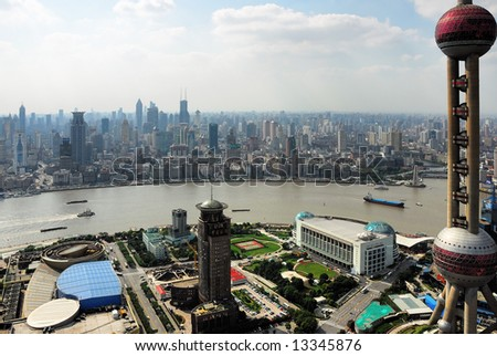China Shanghai  the pearl tower, the Bund and Puxi skyline - stock photo