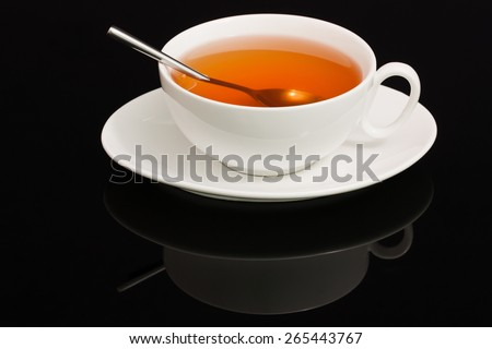 china teacup on a black background - stock photo