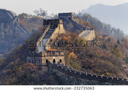 China The great wall distant view compressed towers and wall segments autumn season in mountains near Beijing ancient chinese fortification military landmark - stock photo